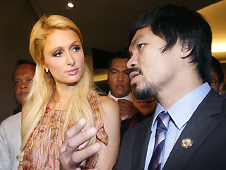 Socialite Paris Hilton and Sarangani Rep. Manny Pacquiao chat as they emerge from a dinner meeting at a Makati hotel on Tuesday. <b>Reuters-Cheryl Ravelo</b>