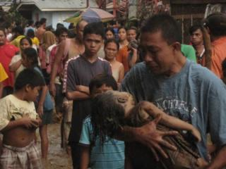Father loses child to Storm Sendong in Cagayan de Oro