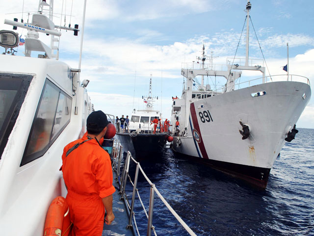 Philippine, Chinese coast guards cross paths anew near Panatag Shoal
