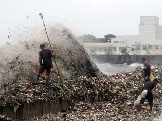 Storm surge leaves Roxas Boulevard awash in trash