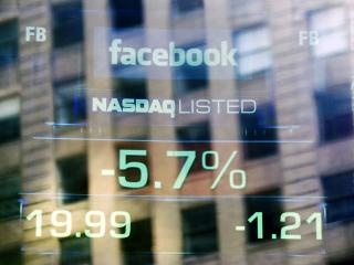 Facebook stock price falls to new low
