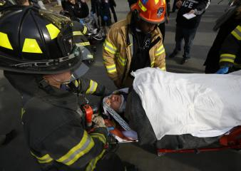 New York City firemen carry a victim of NYC commuter ferry crash