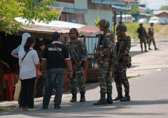 Malaysian troops deployed as Sabah clashes escalate