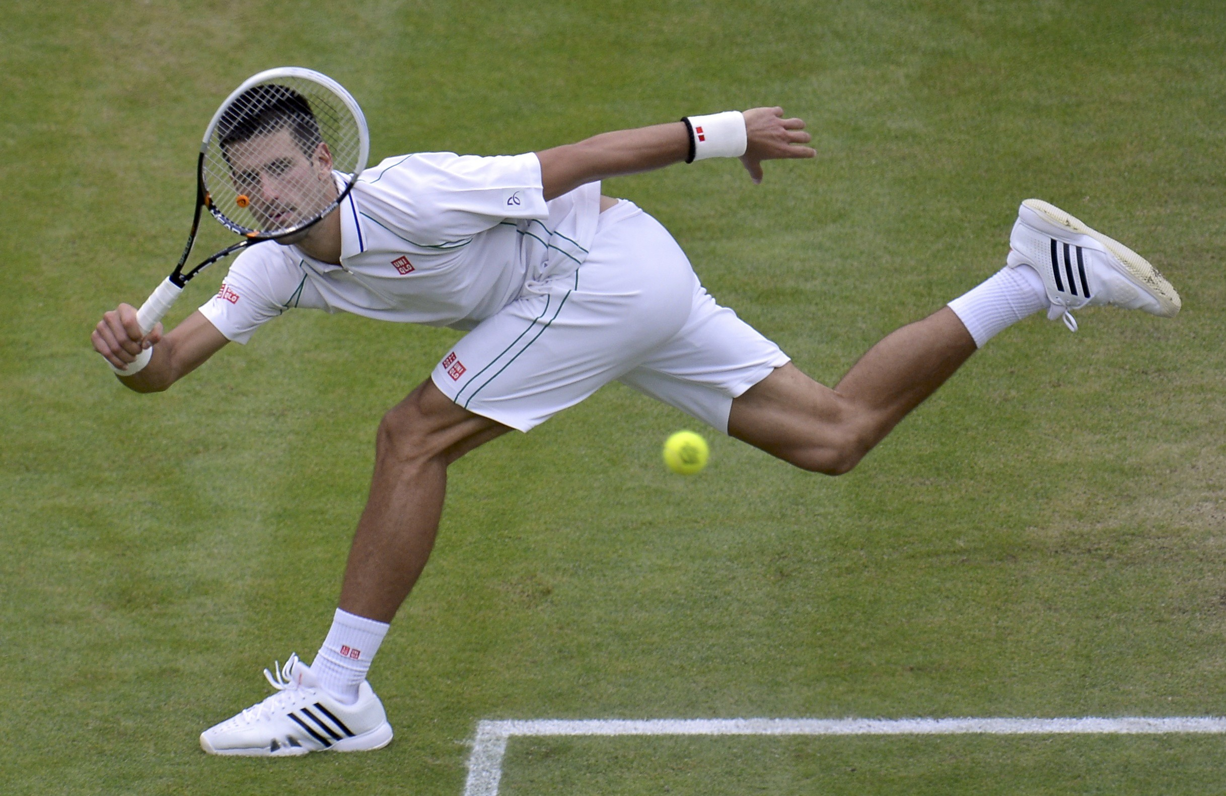 Tennis: On-song Djokovic eases into Wimbledon second round